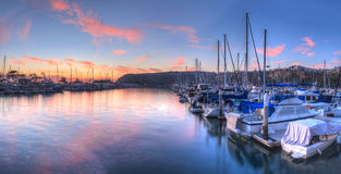 Sunset over sailboats in Dana Point harbor. In the fall Royalty Free Stock Photo