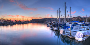 Sunset over sailboats in Dana Point harbor. In the fall Stock Photography