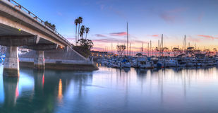 Sunset over sailboats in Dana Point harbor Stock Photography