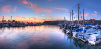 Sunset over sailboats in Dana Point harbor Stock Photos