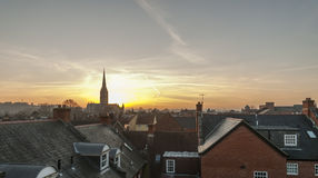 Sunset over Salisbury Cathedral Salisbury Wiltshire. With houses of the city in the foreground Royalty Free Stock Images