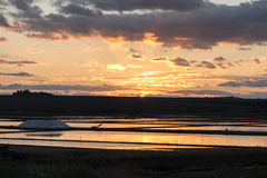 Sunset over saltworks Stock Images