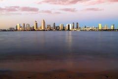 Sunset over the San Diego skyline across San Diego Bay from Coronado Island. The sunset over the San Diego skyline across San Diego Bay from Coronado Island Stock Photo