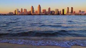The San Diego Skyline. Sunset over the San Diego skyline across San Diego Bay from Coronado Island stock footage