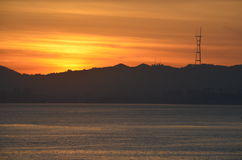 Sunset over the San Francisco bay. Sutro Tower admires the sunset over the San Francisco bay Stock Image