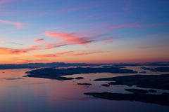 Sunset over the San Juan Islands. Gorgeous calming sunset over the San Juan Islands in Washington State - aerial image Royalty Free Stock Photo