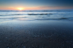 Sunset over sand beach at low tide on North sea Royalty Free Stock Photography
