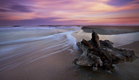 Sunset over sandy beach on the Atlantic shore Stock Photos