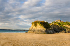 Sunset over a Sandy Beach in Cornwall Royalty Free Stock Image