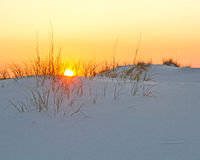 Sunset Over a Sandy Beach Royalty Free Stock Images