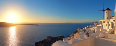 Sunset over Santorini island in Greece. Traditional church, apar Royalty Free Stock Image