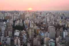 Sunset over Sao Paulo. Tower blocks in the city of Sao Paulo as the sun sets Stock Photos