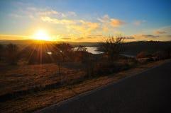 Sunset over Sardinia. Sunset in Sardinia overlooking a hilly landscape Stock Photo
