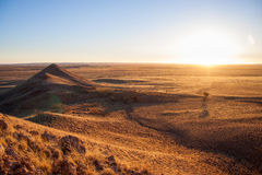 Sunset over savannah of Namib-Naukluft National Park, Namibia Royalty Free Stock Photo