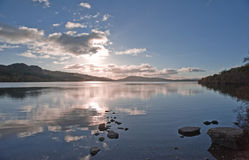 Sunset over Scottish Loch. Royalty Free Stock Photo