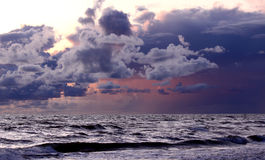 Sunset over sea. Horizon with dramatic cloudscape Stock Photos