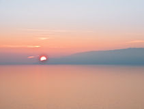Sunset over the sea. In the photo Royalty Free Stock Photos
