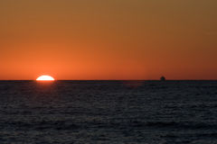 Sunset over sea. With yellow Stock Photos