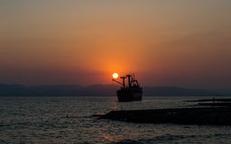 Sunset over the sea. On the background of the ship Royalty Free Stock Photography