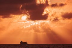 Sunset over the sea. Backgrounds for quotes. Ship sailing on the sea in the rays of setting sun Royalty Free Stock Photos