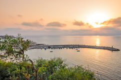 Sunset over bay for fishing boats Royalty Free Stock Photography