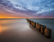 Sunset over the sea beach Stock Photography