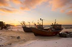 Sunset over the sea beach Stock Photos