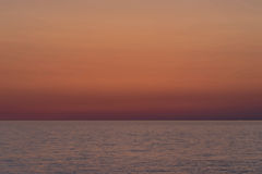 Sunset over the sea. Beautiful and colorful sunset over the sea Royalty Free Stock Photos