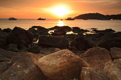 Sunset over the sea with beautiful rocks Royalty Free Stock Photos