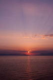 Sunset over the sea with blue purple hue, vertical Royalty Free Stock Image