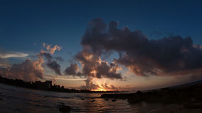 Sunset over sea - caribbean tropical waterfront in clouds Royalty Free Stock Image