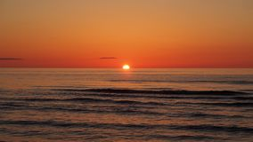 Orange red sunset and sun over sea Royalty Free Stock Photo
