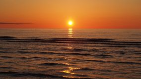 Orange red sunset and sun over sea Stock Image
