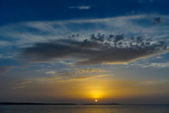 Sunset over sea with clouds. Royalty Free Stock Photography