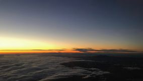 Sunset over the sea of clouds Stock Photography
