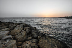 Sunset over the sea on the coast Stock Photography
