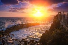 Sunset over sea coast Royalty Free Stock Photos