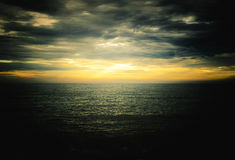 Sunset over the sea with a dark vignette Stock Photos