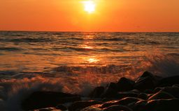 Sunset Over The Sea. Evening. Black sea seaside. Sunset Over The Sea with splashing waves. Evening on the seashore. Black sea seaside stock image