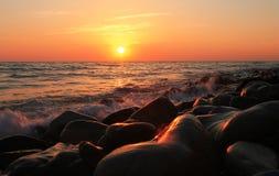 Sunset Over The Sea. Evening. Black sea seaside. Sunset Over The Sea with splashing waves. Evening on the seashore. Black sea seaside royalty free stock photos