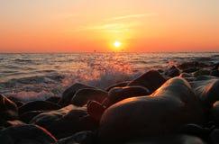 Sunset Over The Sea. Evening. Black sea seaside. Stones on the seashore and Sunset Over The Sea background. Evening on the seashore. Black sea seaside royalty free stock photos