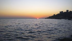 Sunset Over The Sea. Evening on the seashore. Black sea seaside. The Sunset Over The Sea. Evening on the seashore. Black sea seaside, Sochi, Russian Federation royalty free stock images