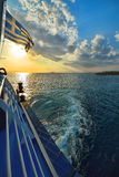 Sunset over sea on ferry in Greece Stock Photo