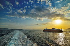 Sunset over sea on ferry in Greece Royalty Free Stock Image
