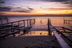 Sunset over the sea and the fishing pier Royalty Free Stock Image