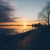 Sunset over the sea - grainy retro vintage Stock Photography