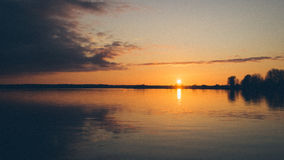 Sunset over the sea - grainy retro vintage Royalty Free Stock Photo