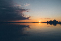 Sunset over the sea - grainy retro vintage Royalty Free Stock Photography