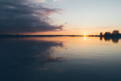 Sunset over the sea - grainy retro vintage Royalty Free Stock Image