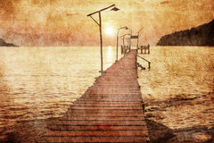 Sunset over the sea in grunge style Royalty Free Stock Image